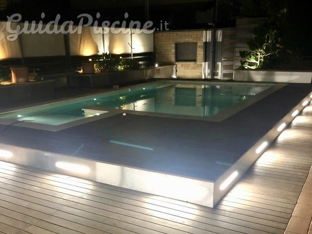 piscina interrata con area relax idromassaggio