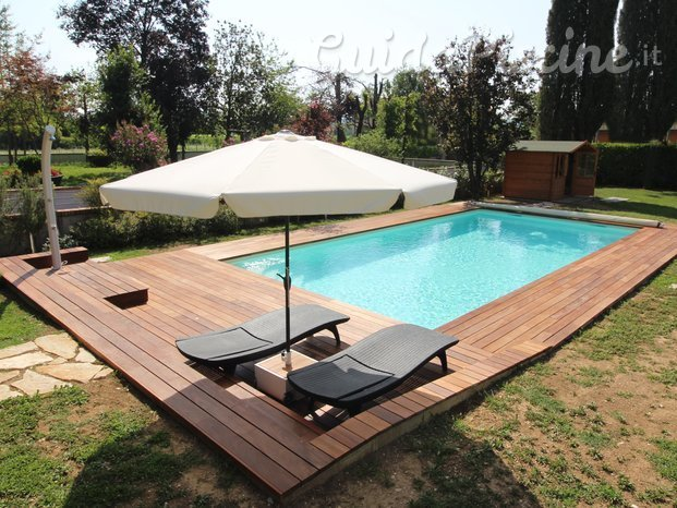 Immagini di aquazzura piscine for Soluzioni x giardino
